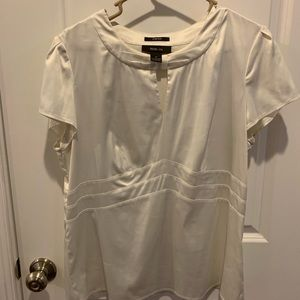 2/$10.  White stretch silky blouse